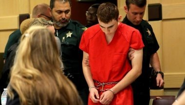 Nikolas Cruz, facing 17 charges of premeditated murder in the mass shooting at Marjory Stoneman Douglas High School in Parkland, appears in court for a status hearing before Broward Circuit Judge Elizabeth Scherer in Fort Lauderdale, Florida, U.S. February 19, 2018.   REUTERS/Mike Stocker/Pool - RC1C1B8BF0E0