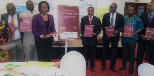 the Attorney General of Uganda William Byaruhanga   receiving a copy of child -friendliness  report