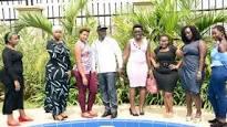 Hon. Kiwanda posing  with Missy curvy contestants in Kampala.