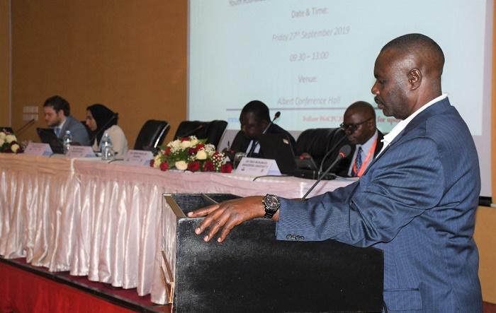 Deputy Jacob Oulanya Addressing youth Round-Table at Munyonyo