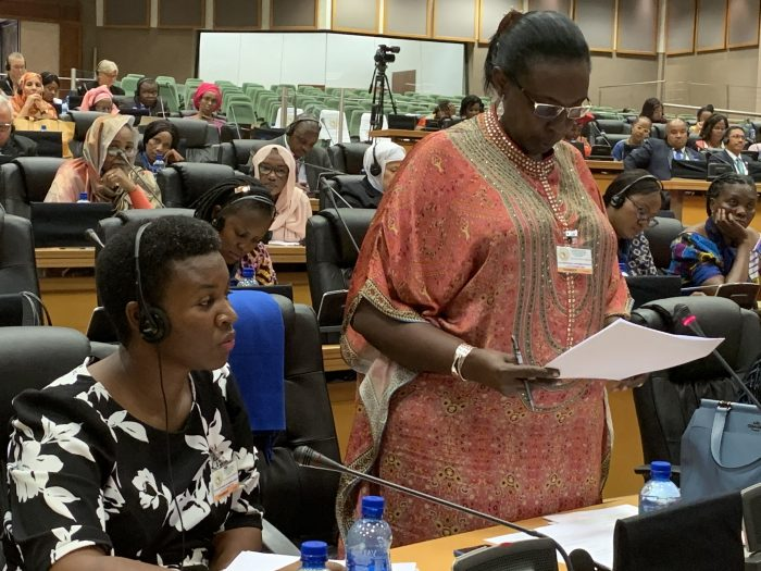 Hon.-Robina-Rwakoojo-makes-a-contribution-during-the-PAP-Conference-on-womens-rights-in-Midrand-South-Africa.-To-her-right-is-Hon.-Justine-Khainz