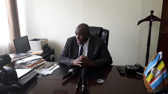 Minister of State for Lands, Housing and Urban Development (Housing)  Dr. Chris Baryomunsi speaking to Journalists