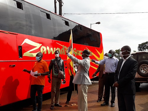Uganda Cancer Institute Management Led (UCI) Executive Director , Dr Jackson Orem Flagging off over 70 stranded Cancer outpatients due to Lock-down to Eastern Route Last Month.