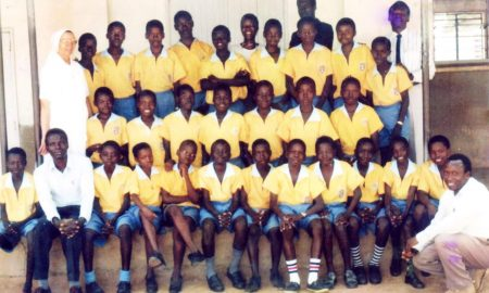 The Candidates of Primary Seven Class of 1994 shortly before PLE together with their teachers and headteachers , Sr Guliana