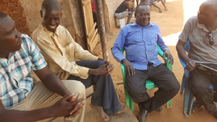 Some Old Boys of Bishop Angelo Negri Primary School led by David Martin Aliker have a chat with their former Maths /Music Teacher Mr .Abacu . He retired from teaching and now runs a business at Cooper center . they had gone to check on an OB , kIDEGA Who well . on the left is Francis Okot Ladwer
